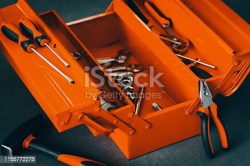 1155772265 istock photo repairman red toolbox professional wrench tool kit 1155772273