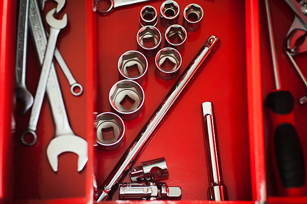 Repairman red toolbox with wrench kit Red toolbox with metal work wrench kit of repairman. Chrome tools for automobile repair in garage fully unbuttoned stock pictures, royalty-free photos & images