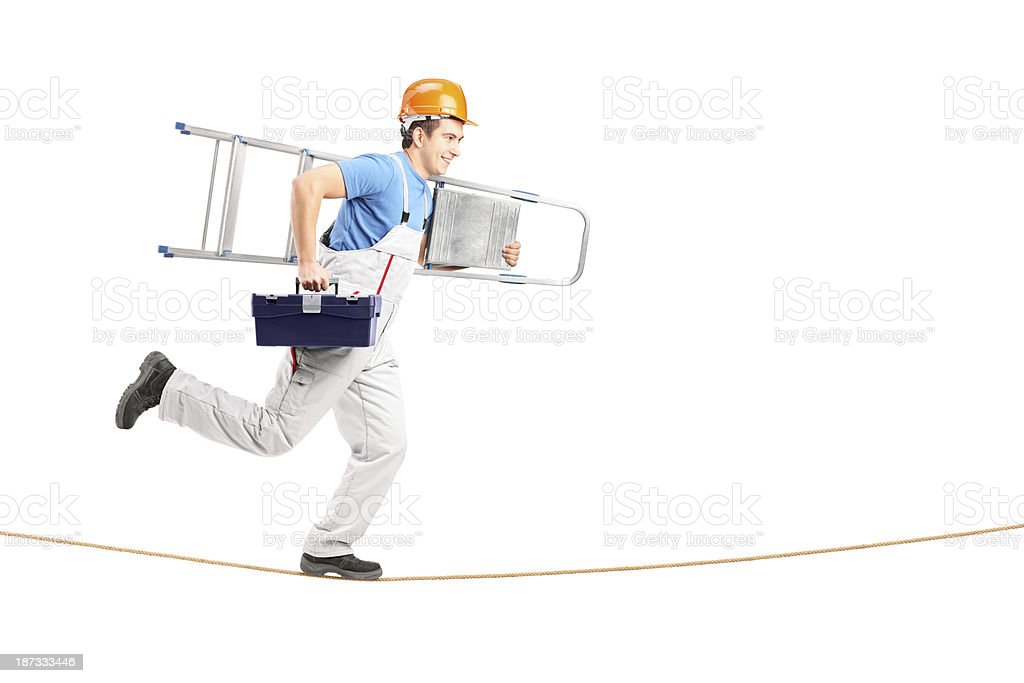 Repairman running on a rope with ladder and tool box royalty-free stock photo