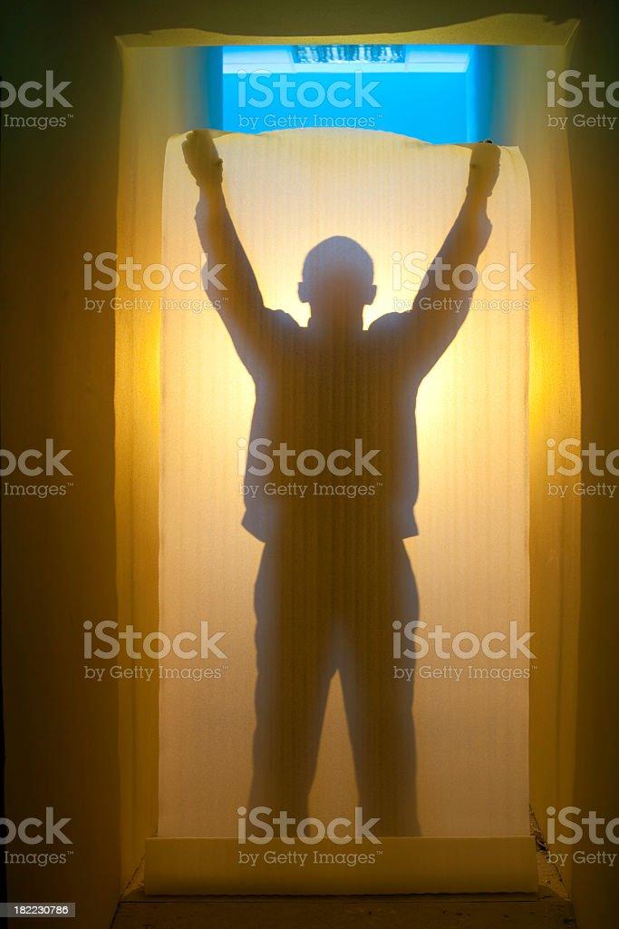 Repairman silhouette in corridor royalty-free stock photo