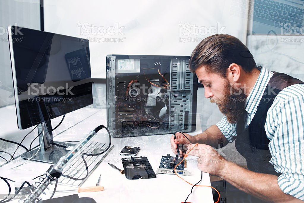 Repairman soldering circuit, double exposure stock photo