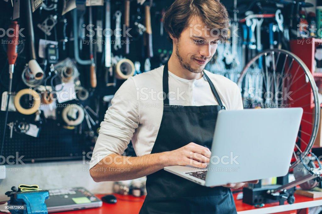 Repairman with laptop stock photo