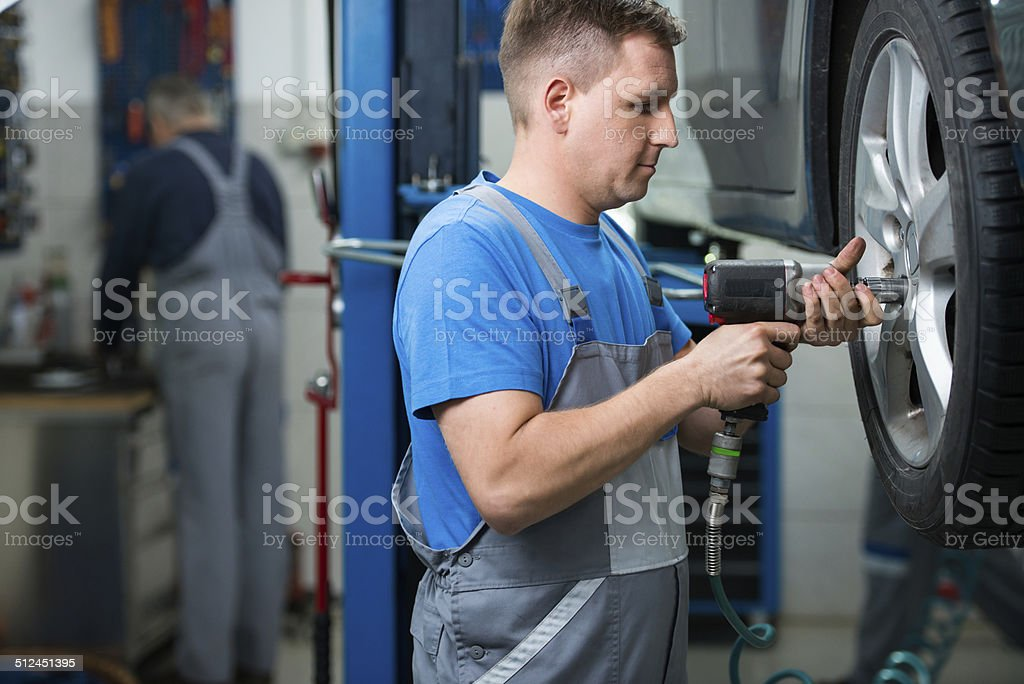 Repairman working in auto repair shop stock photo