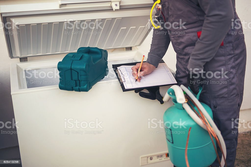 Repairs freezer entering malfunction stock photo