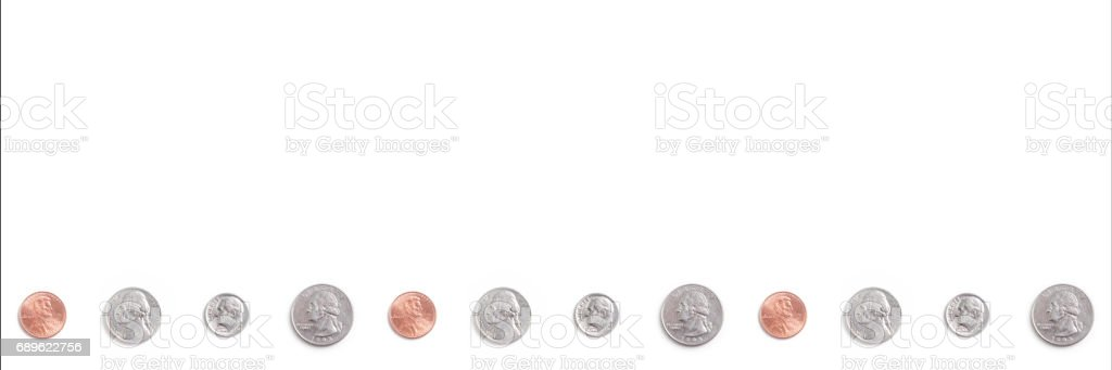 A repeating pattern of US coins on white. stock photo