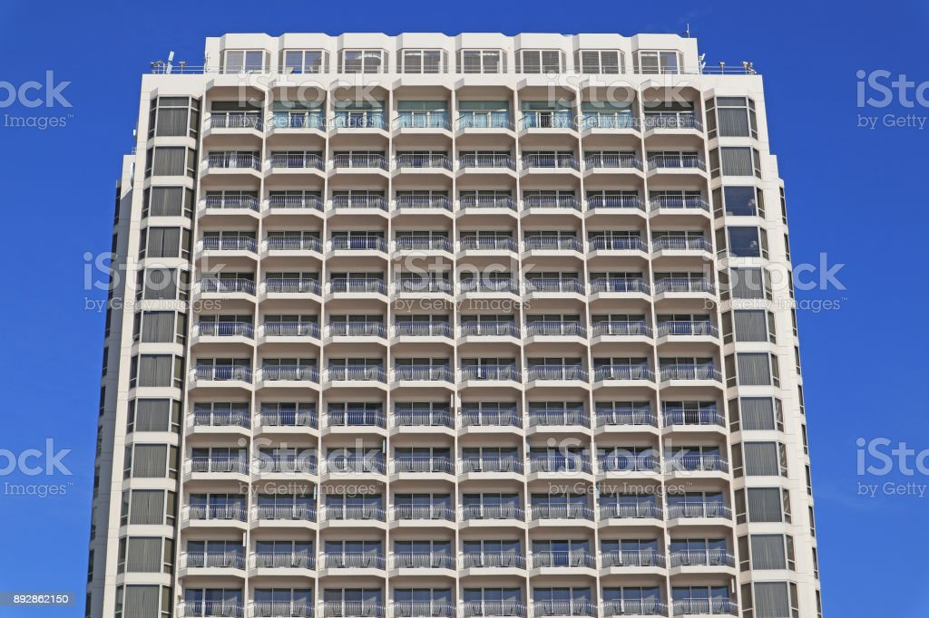 Repeating pattern of windows and balcony. Bulding front stock photo