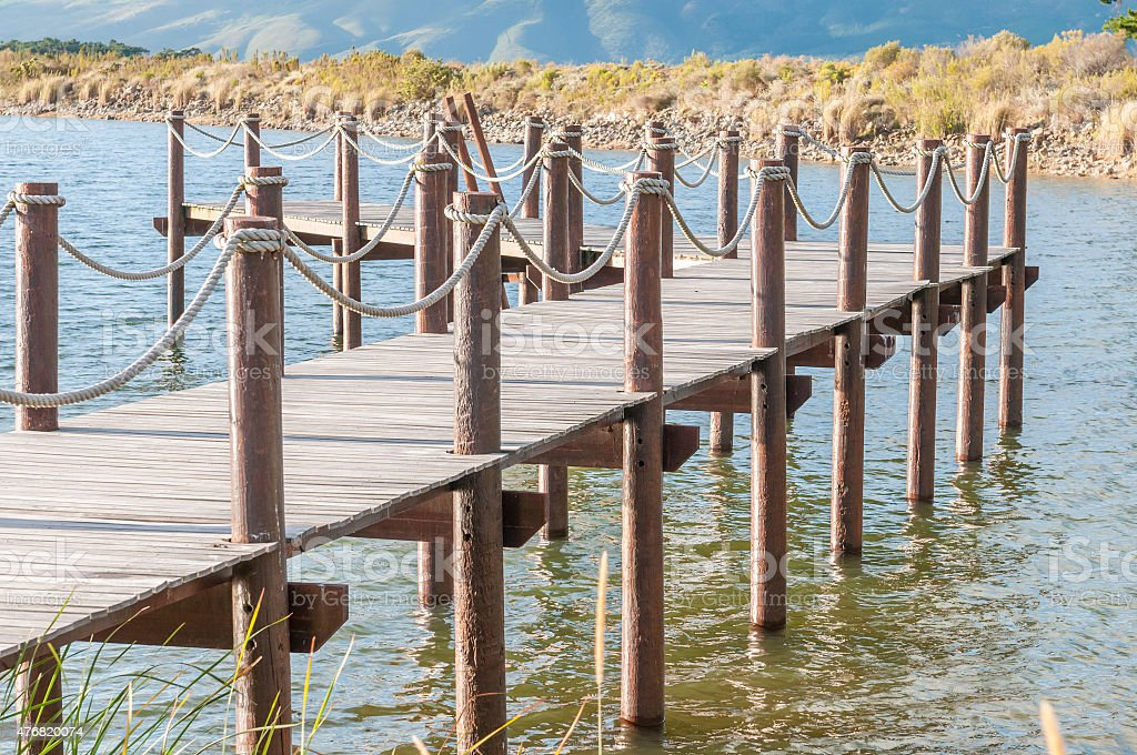 Repeating pattern of wooden poles stock photo