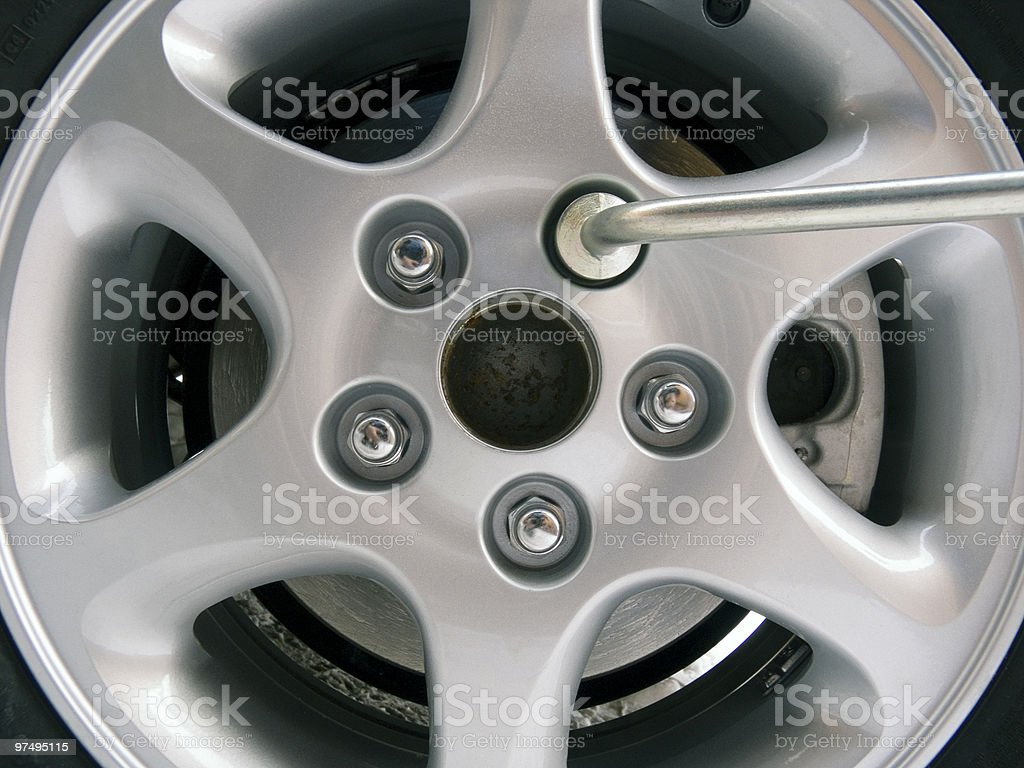 Replacement of an automobile wheel royalty-free stock photo