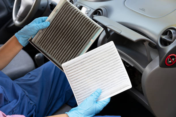 Replacement of cabin pollen air filter for a car Clean and dirty cabin pollen air filter for a car air filter stock pictures, royalty-free photos & images