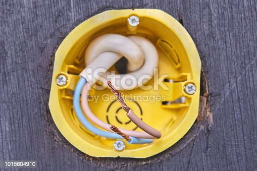1015605026 istock photo Replacement of electrical socket box for power outlet , close-up. 1015604910