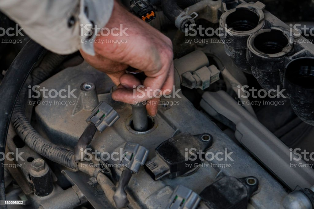 Replacement of spark plugs in the car. stock photo