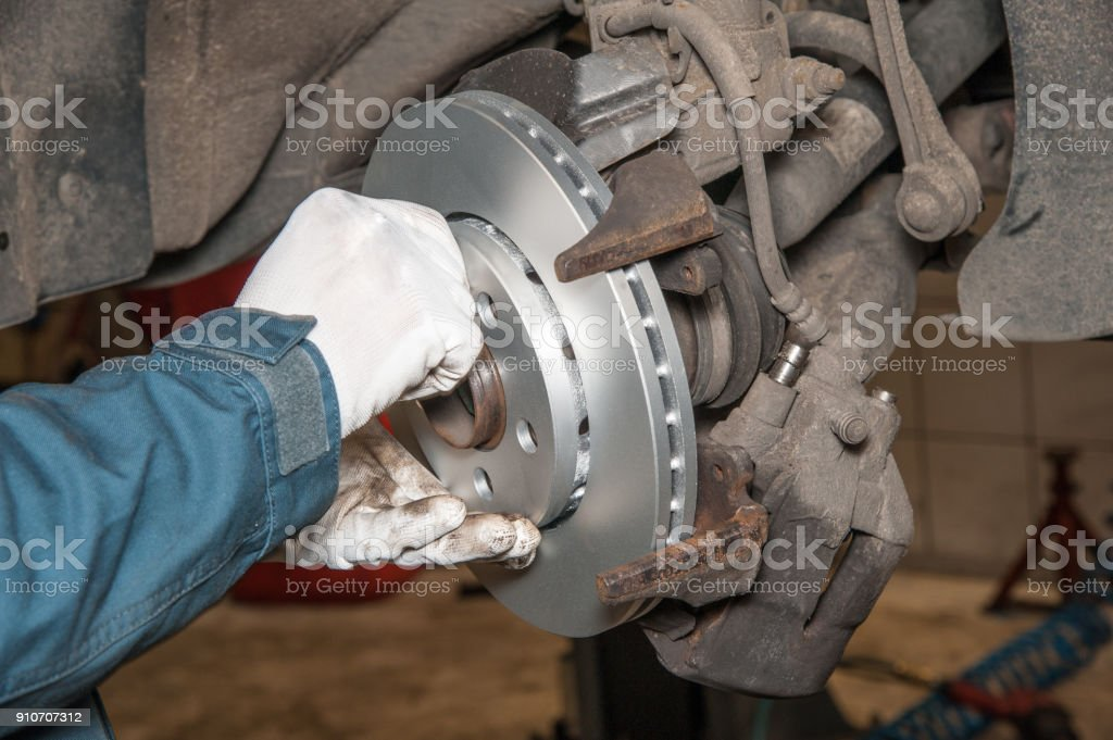 replacement of the brake disc at an authorized service center stock photo
