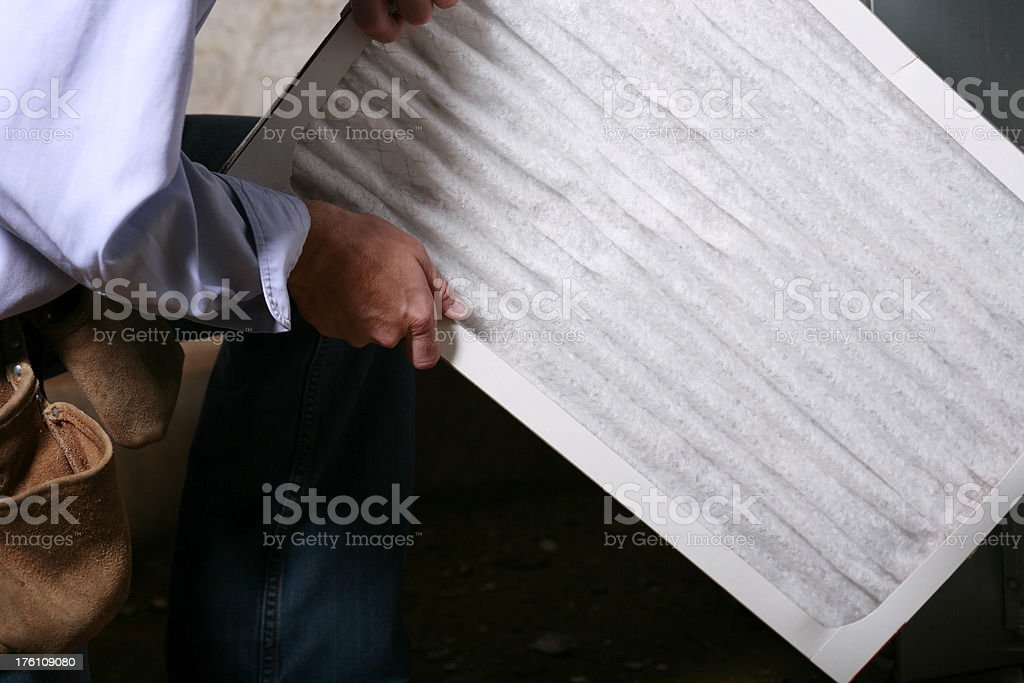 Replacing Air Filter in a Furnace royalty-free stock photo