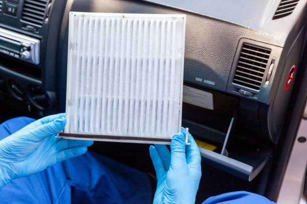 Replacing cabin pollen air filter for a car as prevention against coronavirus disease Replacing cabin pollen air filter for a car air filter stock pictures, royalty-free photos & images