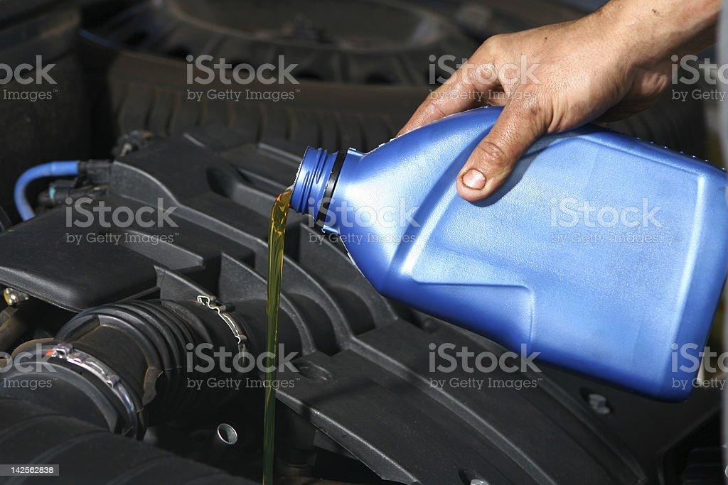 Replacing car engine oil stock photo