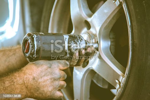 498888104 istock photo Replacing car wheel and tyre 1035413838