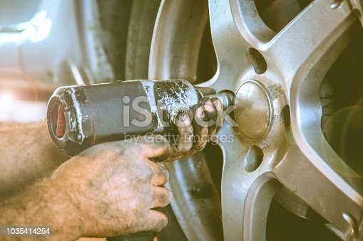 498888104 istock photo Replacing car wheel and tyre 1035414254
