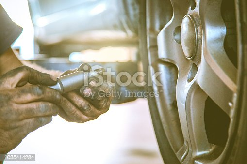 498888104 istock photo Replacing car wheel and tyre 1035414284