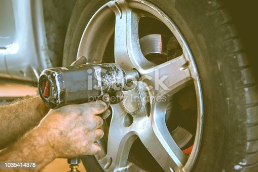 498888104 istock photo Replacing car wheel and tyre 1035414378