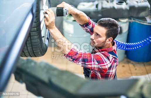 498888104 istock photo Replacing car wheel and tyre. 500569126