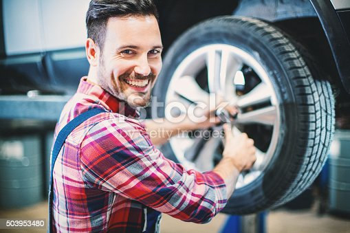 498888104 istock photo Replacing car wheel and tyre. 503953480