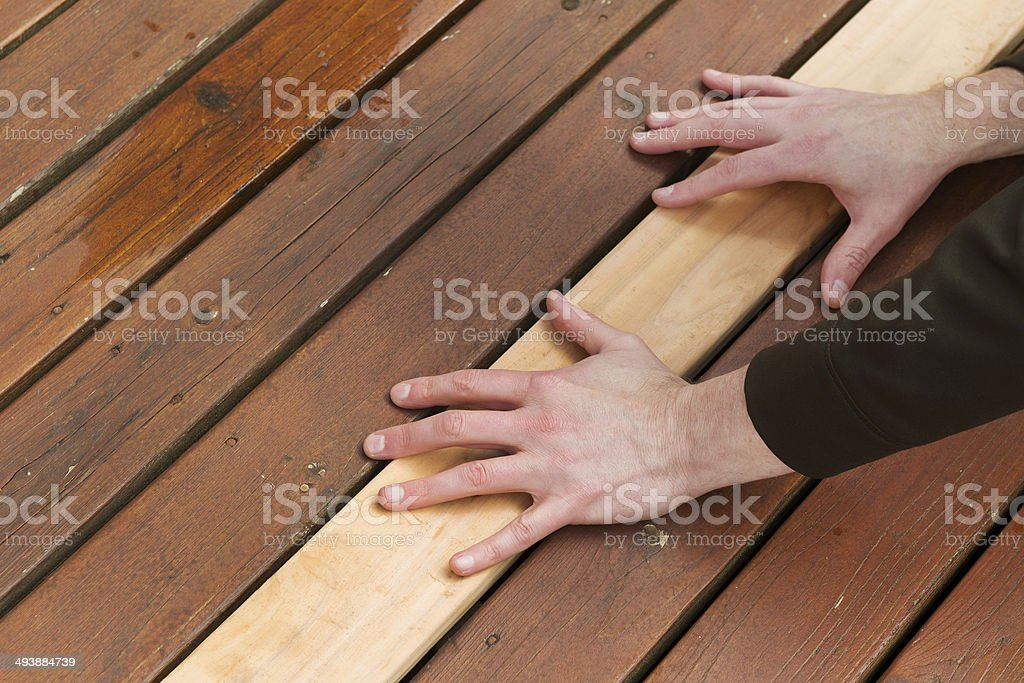 Replacing Cedars Boards on Deck stock photo