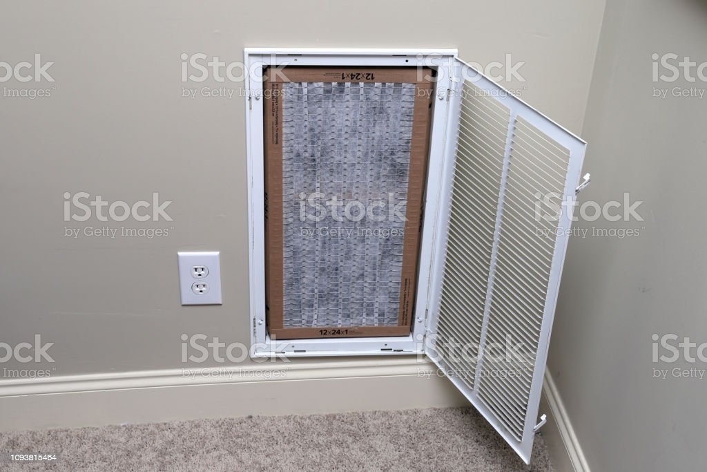 replacing clean air filter for air conditioner maintenance stock photo