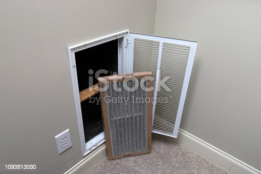 istock Replacing dirty air filter for air conditioner system maintenance 1093813030