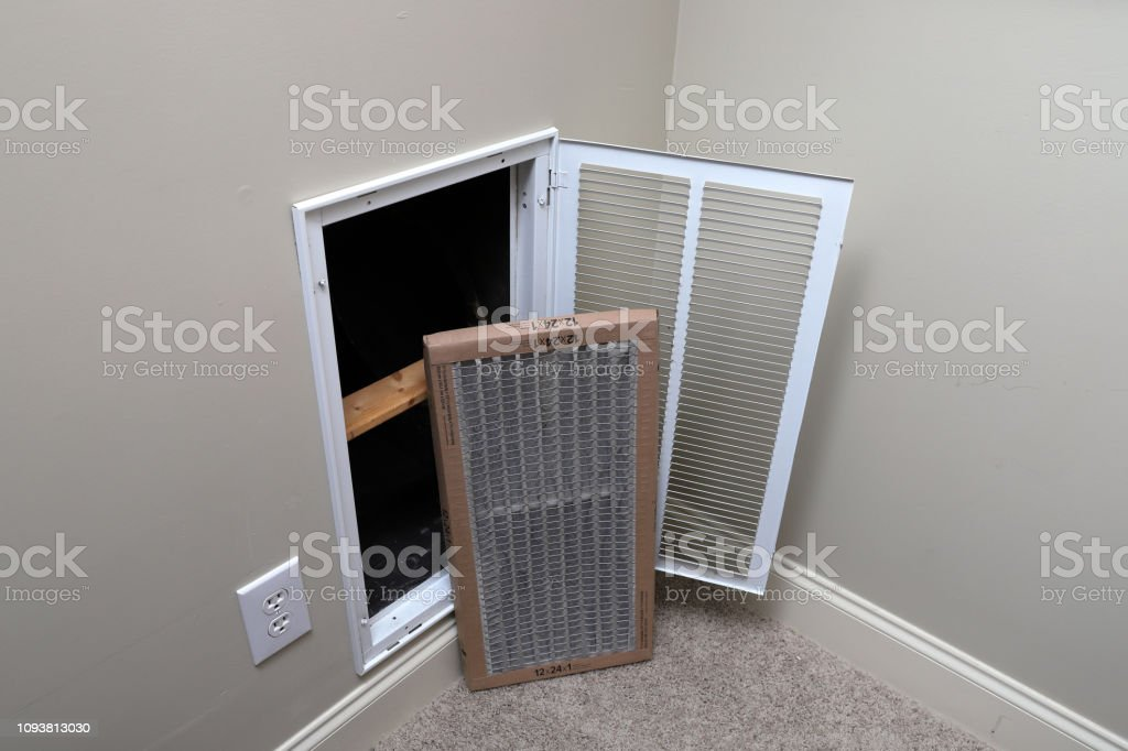 Replacing dirty air filter for air conditioner system maintenance stock photo