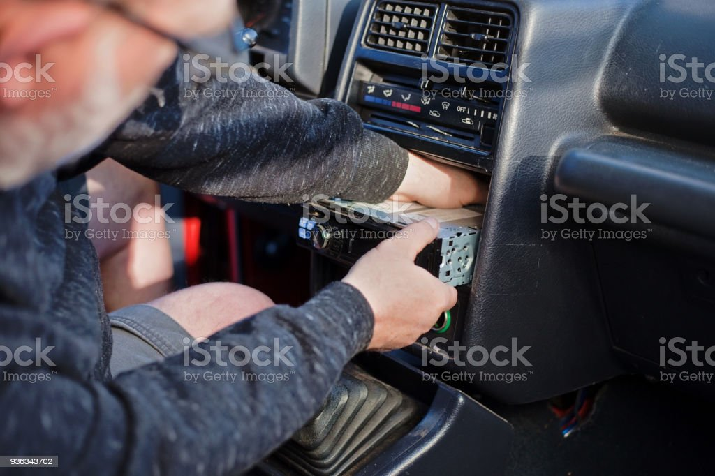 Replacing Old Car Stereo stock photo