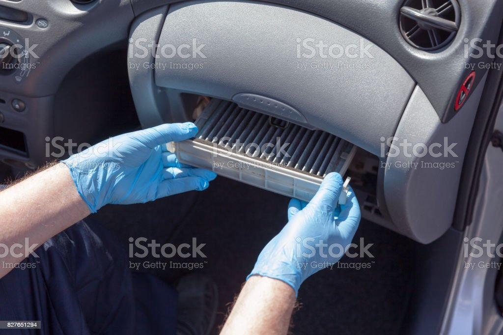 Replacing the cabin air filter stock photo