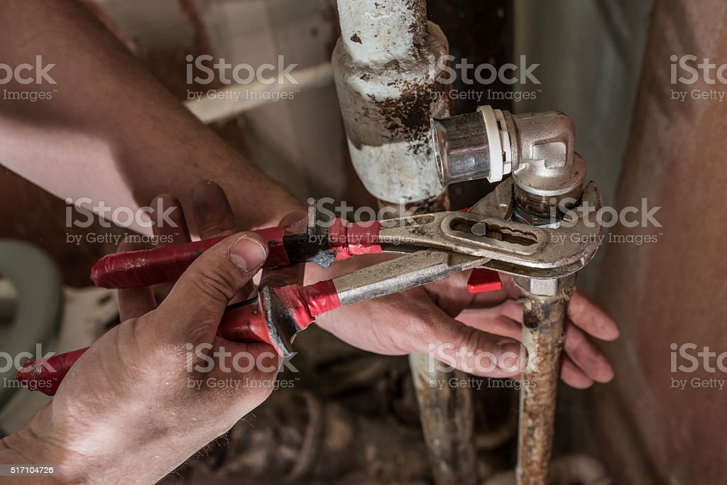 Replacing the faucet in the bathroom stock photo