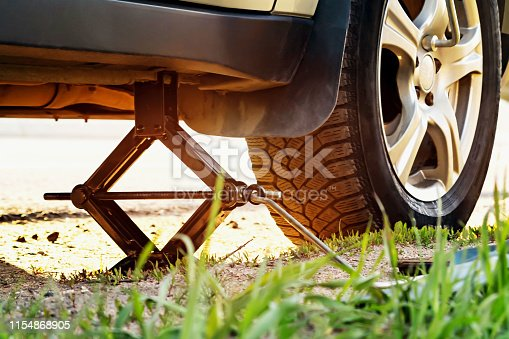 Replacing the wheels on the highway, the car is jacked, unscrewing the nuts with a tire iron.