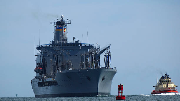Replenishment Oiler San Diego, CA, USA – July 12, 2014: US navy replenishment oiler being toed to San Diego's naval base, CA, USA. naval base stock pictures, royalty-free photos & images