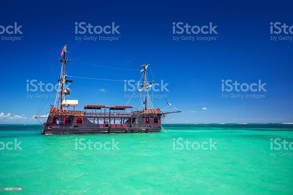 Replica of an old ship in the Caribbean sea stock photo