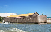 Rotterdam, Netherlands – August 18, 2016: In one of the ports of Rotterdam lie Noah's Ark docked. The ark is 30 meters wide, 23 meters high and 135 meters long.