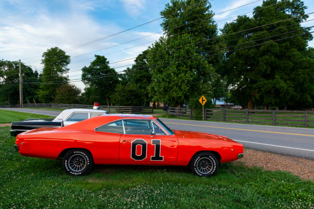 Replicas of the General Lee Charger and the Sheriff car, from the television series The Dukes of Hazzard stock photo