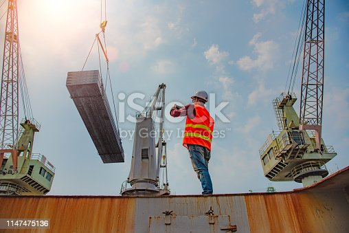 worker, loading master, loading controller or engineering connecting device online and taking photo to send quick a report of the job working in progress at job site