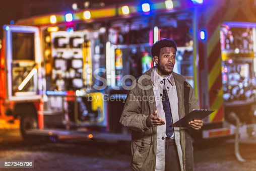 istock TV reporter about night arson 827345796