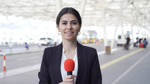 TV reporter at the airport stock photo