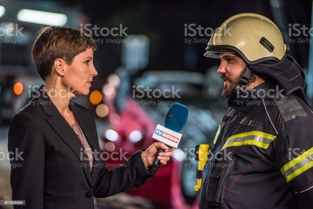 Reporter covering news'n stock photo