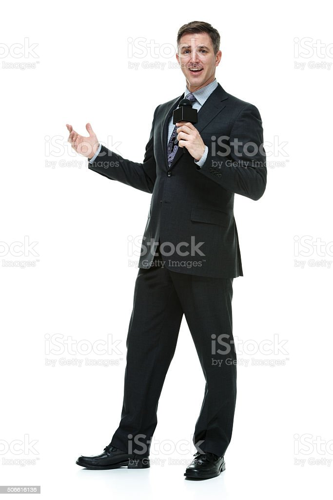 Reporter in action with microphone stock photo