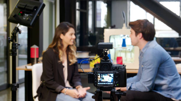 Reporter interviewing in a 3D printing office stock photo