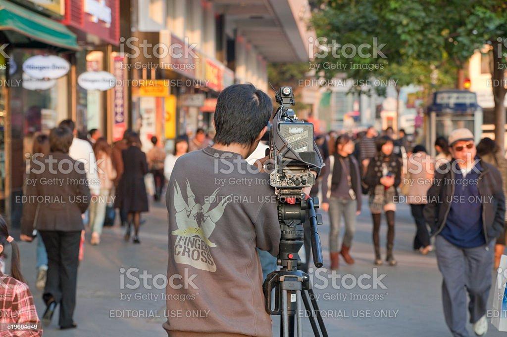 TV Reporter shooting Street Scene stock photo