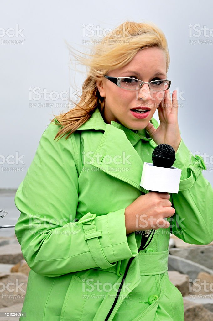 Reporting Live: The Channel X Weather Girl stock photo