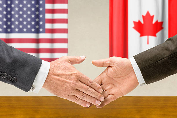 Representatives of the USA and Canada shake hands Representatives of the USA and Canada shake hands foreign affairs stock pictures, royalty-free photos & images