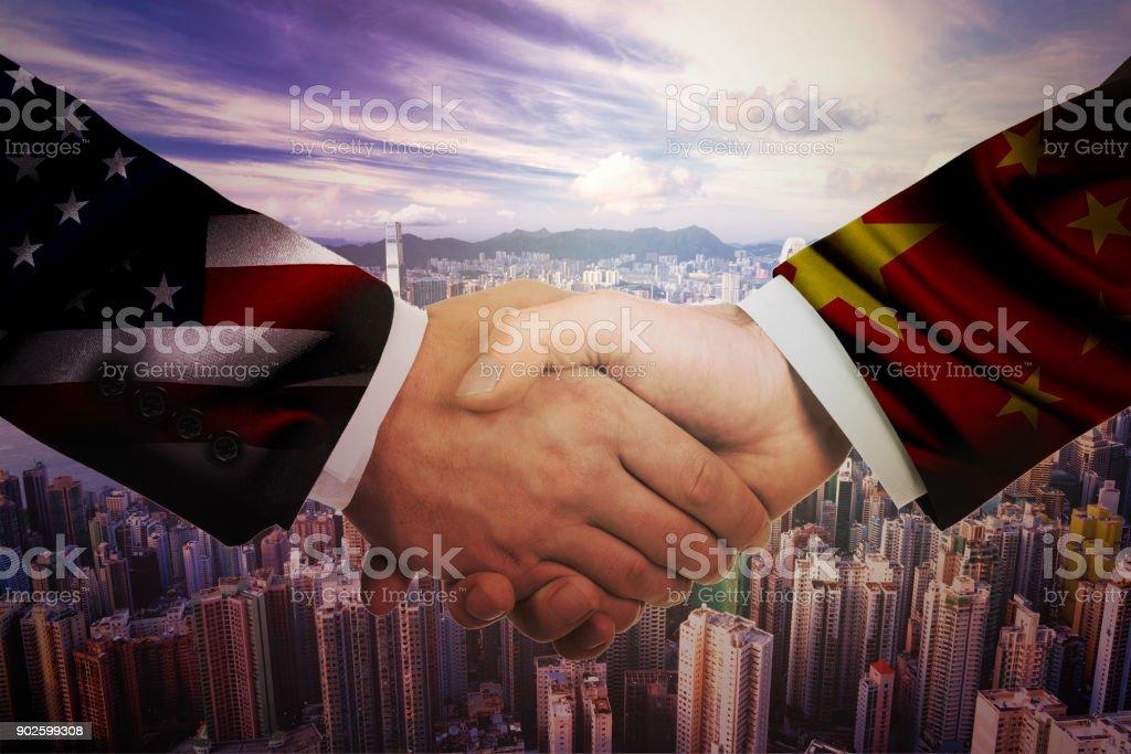 Representatives of the USA and China shake hands stock photo