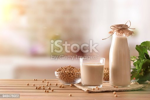 887350996 istock photo Reptientes with soy milk and grains in rustic kitchen background 945475022