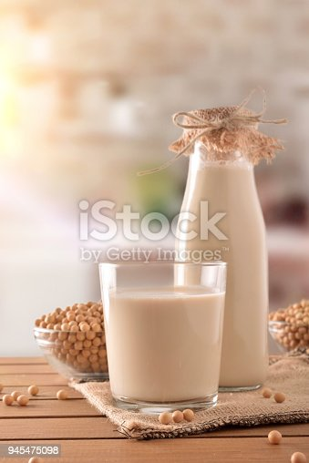 887350996 istock photo Reptientes with soy milk and grains rustic kitchen background vertical 945475098