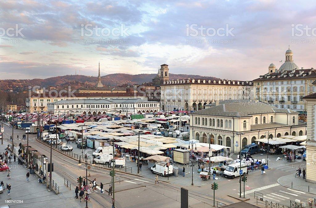 Repubblica square, Porta Palazzo 's market, Turin's hills background stock photo
